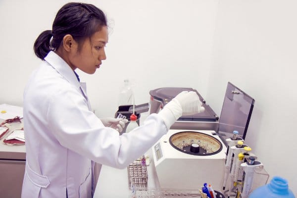 researcher analyzing prp centrifuge